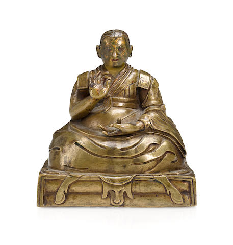 A Tibetan Lama seated on an animal skin