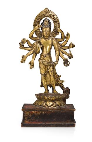 A Nepalese Gilt bronze figure of Amoghapasa
