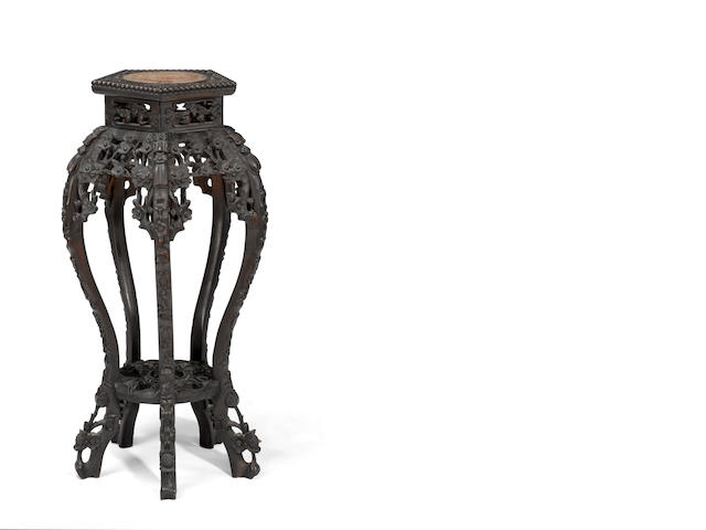 A Chinese carved hardwood plant stand