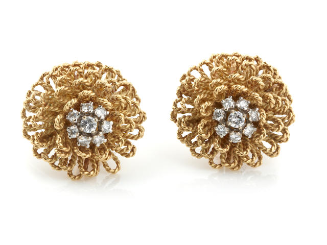 A pair of diamond and and 18k gold ear clips, 17.3 grams