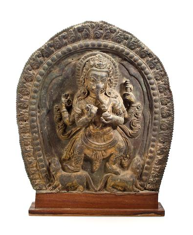A gilt copper repousse Ganesha Nepal, 19th century