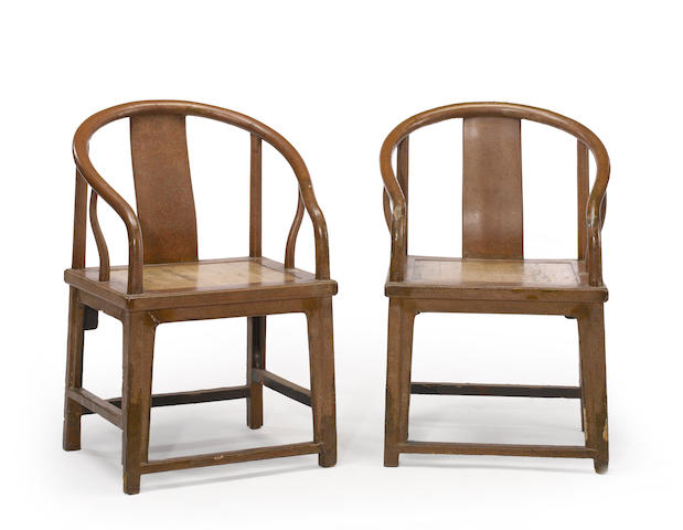 A pair of unusual lacquered wood horseshoe back armchairs 18th/19th century