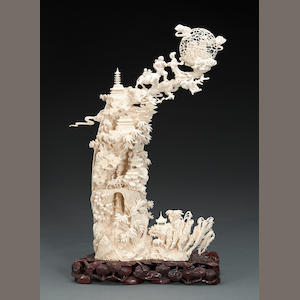A carved and pieced ivory mythical landscape 20th century