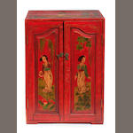A Chinoiserie decorated red painted small two door cabinet