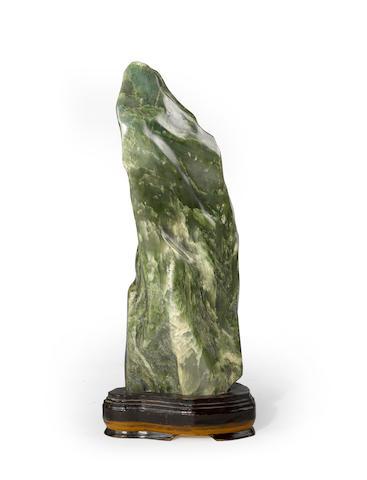 A carved nephrite boulder