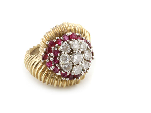 A diamond, ruby and bicolor gold cluster ring