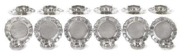 A set of twelve Mexican hand hammered sterling silver dessert bowls and underplates, Ortega