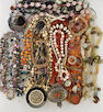 a group of 22 pieces, including 12 crystal bead and metal bead necklaces, 3 bracelets, 1 cufflink, 1 pin, 2 earrings, 1 buckle, and 2 rings