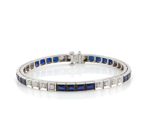 A synthetic sapphire, diamond and 14k white gold line bracelet
