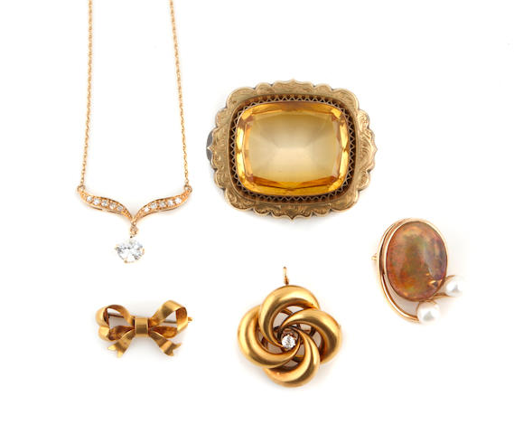 A group of gem-set, gold and white gold jewelry