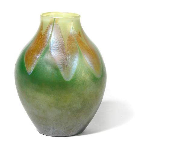 A Tiffany Studios Favrile glass vase with petal decoration at the shoulder