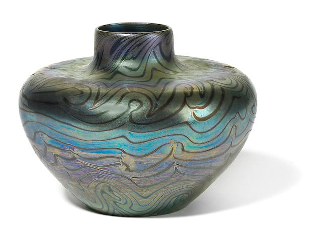 A Tiffany Studios Favrile decorated blue glass vase