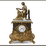 A Louis Philippe gilt and patinated bronze figural mantel clock