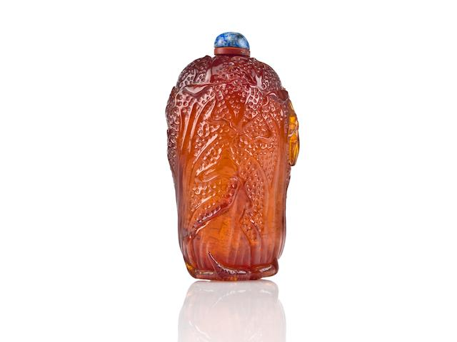 A carved amber snuff bottle in the shape of a cabbage 1780-1880