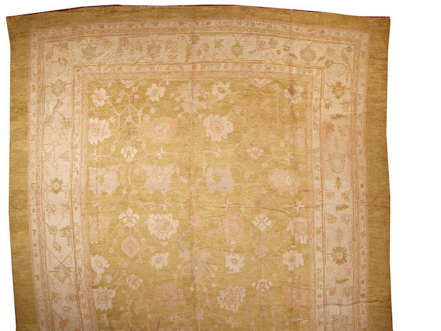 An Oushak carpet West Anatolia size approximately 15ft. x 25ft.