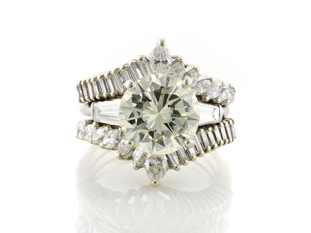 A diamond solitaire ring together with insert ring
