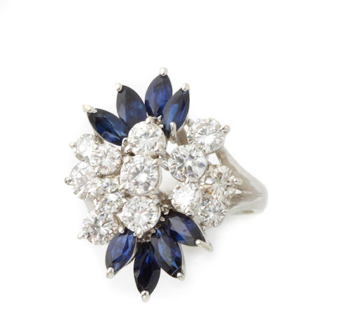 A diamond, sapphire and 14k white gold cluster ring