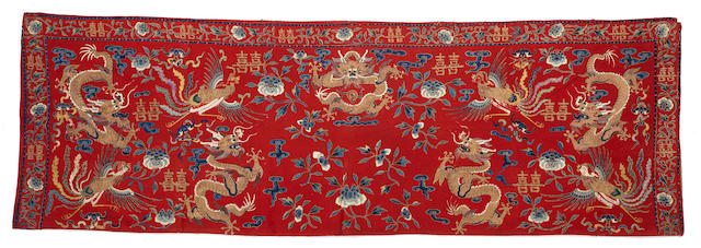 An embroidered red wool horizontal hanging Late Qing/Republic period