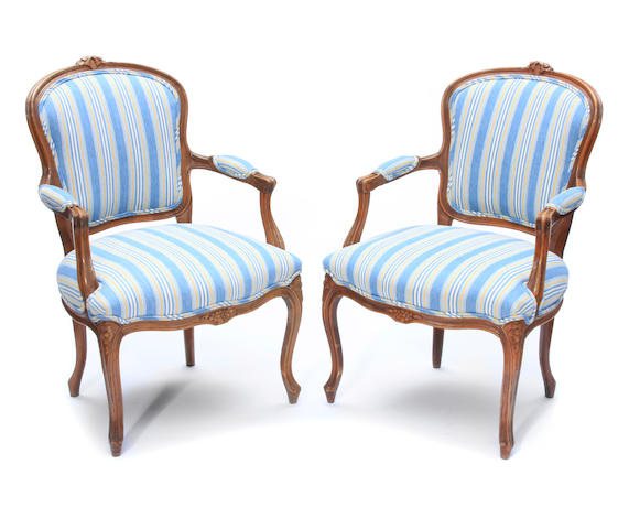 A pair of Louis XV style beechwood fauteuils en cabriolet