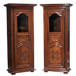 A pair of Louis XVI style walnut bonnetières