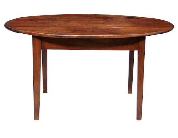 A French Provincial oval walnut farmhouse table