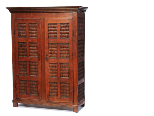 A Continental Baroque oak cupboard