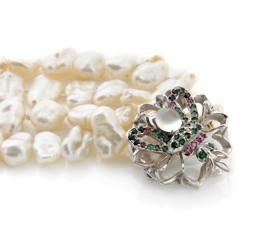A gem-set and silver bug motif clasp together with two strands of wing-shaped pearls
