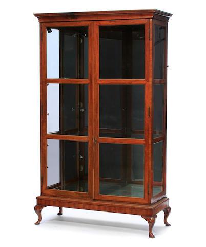 A George II style walnut display cabinet