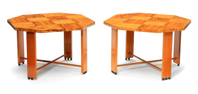 A pair of custom mixed and part ebonized wood octagonal low tables