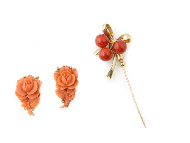 A group of coral and gold jewelry