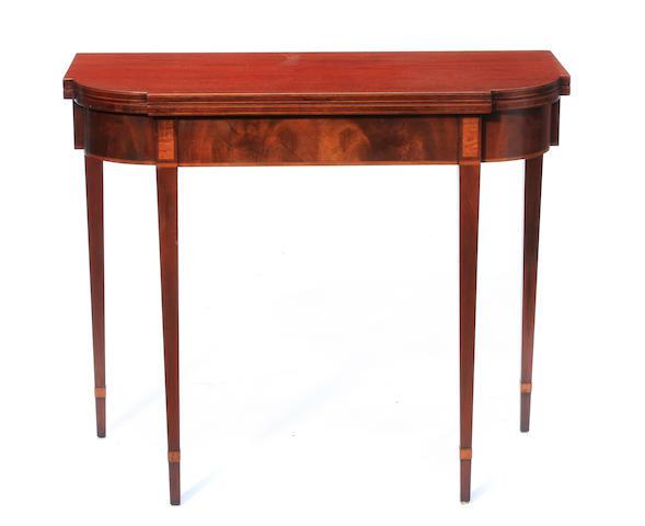 A Federal inlaid mahogany fold top tea table