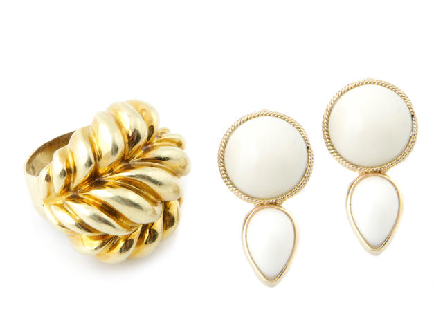 A pair of white coral and 14k gold earclips together with an 18k gold ring