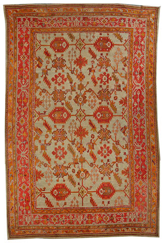 An Oushak carpet  West Anatolia size approximately 9ft. 8in. x 15ft.