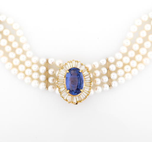 A tanzanite and diamond pendant/enhancer with a cultured pearl four row choker necklace