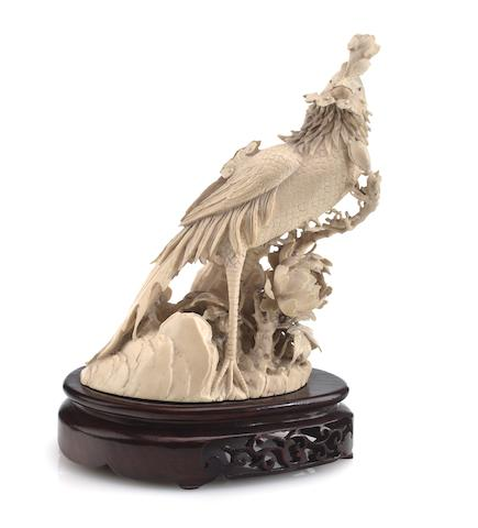 A carved ivory phoenix Mid-20th century