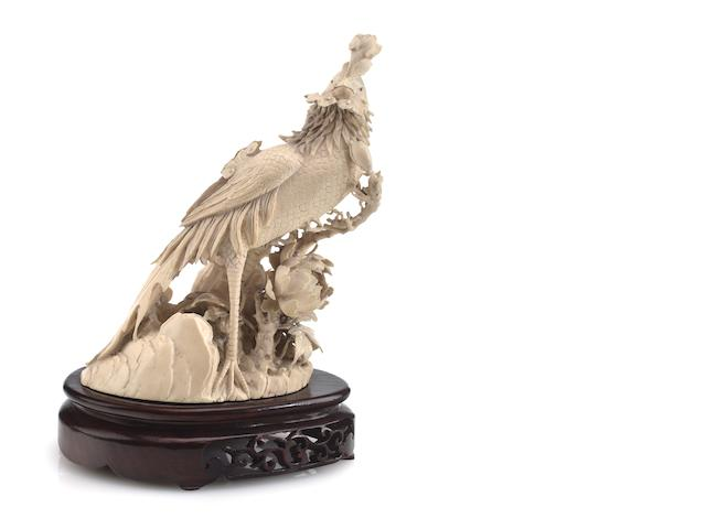 A carved ivory phoenix