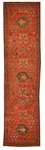 An Oushak runner West Anatolia size approximately 3ft. 2in. x 12ft. 6in.