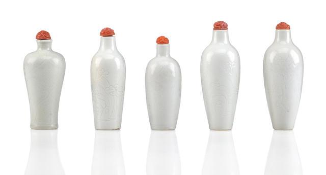 A group of five incised soft paste porcelain snuff bottles Jingdezhen, 1800-1880