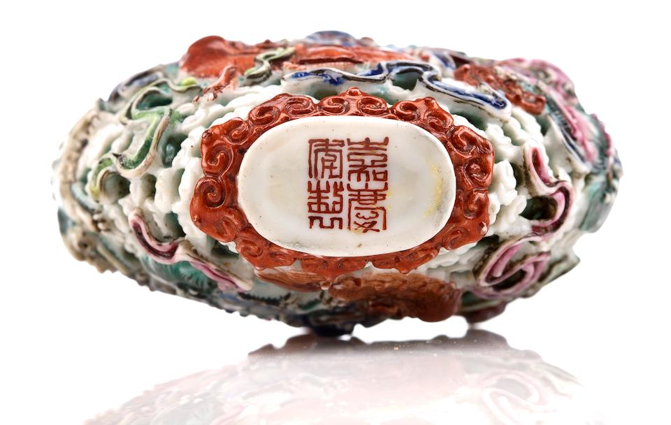 A molded porcelain snuff bottle with nine Buddhist lions Jiaqing mark and period