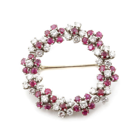 A ruby, diamond and 14k white gold circle flower wreath brooch