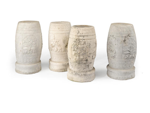 A group of four carved marble seats