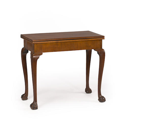 A George II mahogany concertina action card table on cabriole legs ending in ball and claw feet mid 18th century