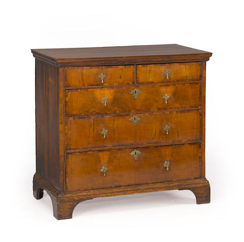 A Queen Anne walnut crossbanded and oak fivedrawer chest of drawers first quarter 18th century