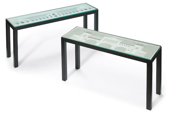 Two Modern black painted metal Palladian camphor-etched puzzle cocktail tables