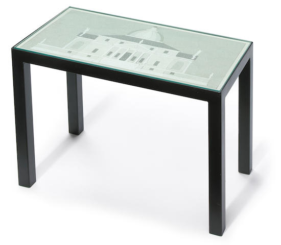 A modern black-painted metal Palladian camphor-etched puzzle cocktail table