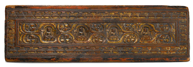 Manuscript cover with four forms of Shakyamuni Buddha Carved and gilded wood Tibet circa 13th century