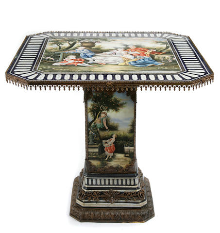 A Louis XVI style gilt bronze mounted parcel gilt paint decorated porcelain center table