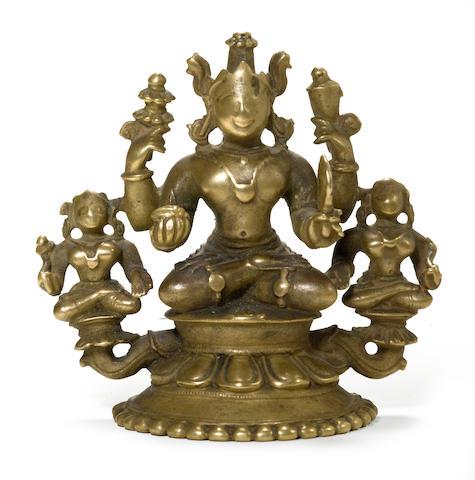 Seated Vishnu and consorts Brass Orissa 17th century