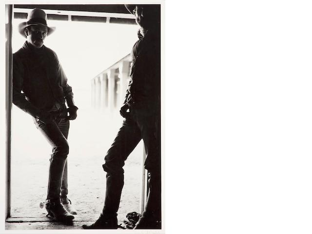 Douglas Kent Hall Hands, T. O. Ranch, 1984 Gelatin silver print, signed in pencil on overmat, in apparently good condition aside from 3 creases between the 2 figures near the bottom of the sheet, framed (not examined out of frame). 60 x 40in