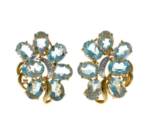 A pair of aquamarine and diamond earrings